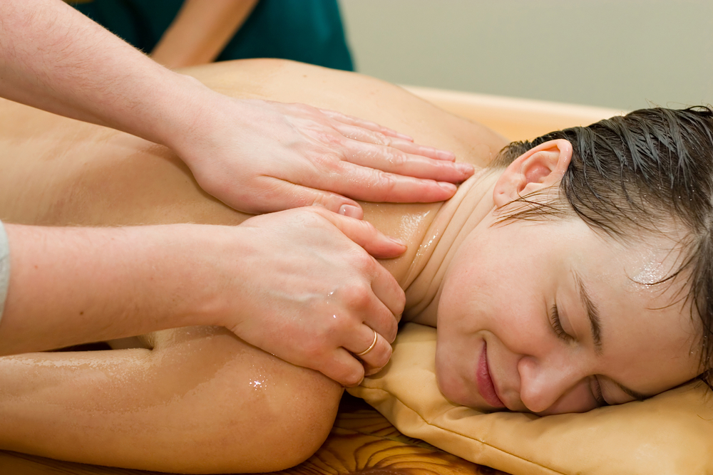 Ayurvedic Therapy Massage Procedure With Oil And Pouch Of Rice And Spices