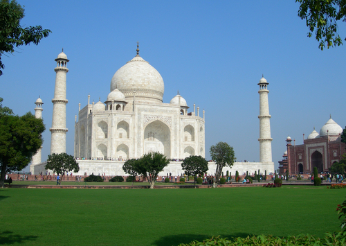 Perspective View Of Taj Mahal Mausoleum Over The Lawn In The City Of Agra India