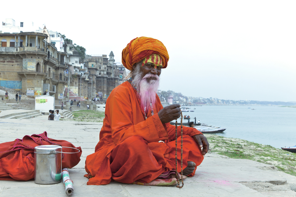 Sadhu At The Ghats In Varanasi India With A Pink B